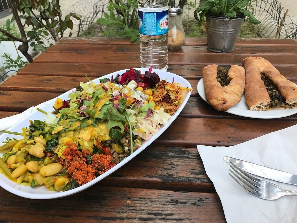 "Photo of Kiez Vegan - Kortestrasse  by <a href=""/members/profile/rhianderson566"">rhianderson566</a> <br/>Large salad plate with calzone <br/> May 23, 2017  - <a href='/contact/abuse/image/48783/261783'>Report</a>"