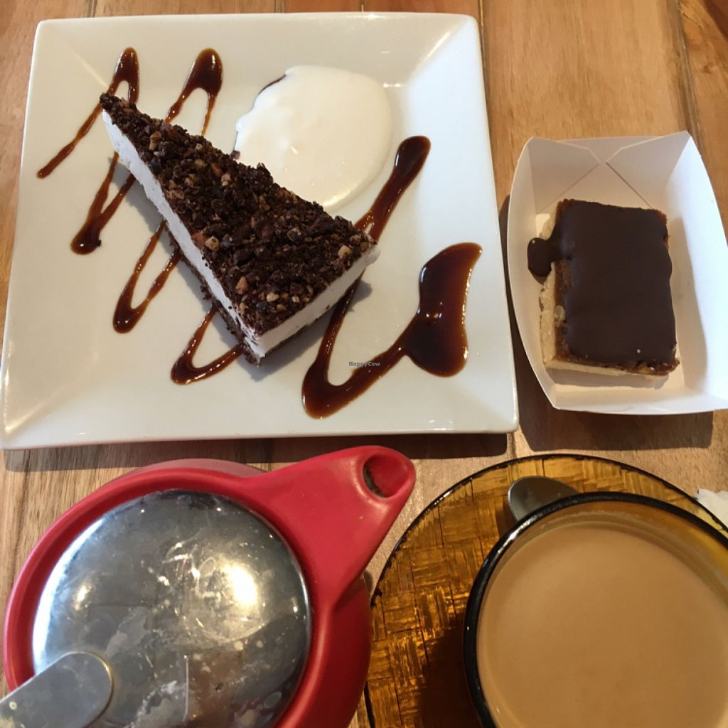 """Photo of Soul Kitchen Bakery  by <a href=""""/members/profile/SeitanSeitanSeitan"""">SeitanSeitanSeitan</a> <br/>Ore-oh cake, Snickers bar and chai latte <br/> April 16, 2016  - <a href='/contact/abuse/image/48897/144892'>Report</a>"""