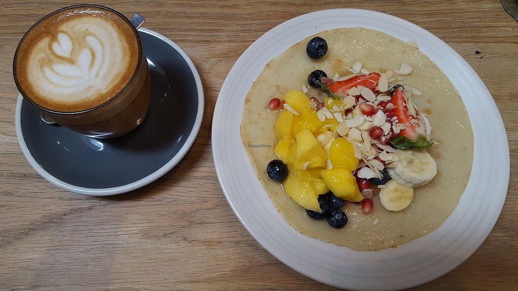 "Photo of Kin Cafe  by <a href=""/members/profile/VeganAnnaS"">VeganAnnaS</a> <br/>Oat milk latte and pancake with fresh fruit and extra nuts - lovely light breakfast <br/> July 5, 2017  - <a href='/contact/abuse/image/49333/276821'>Report</a>"