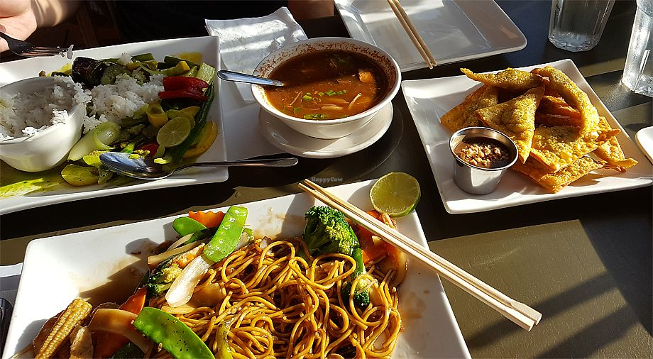 """Photo of My Thai Vegan Cafe  by <a href=""""/members/profile/Seiashun"""">Seiashun</a> <br/>Green curry, hot and sour soup, golden triangles, vegetable noodle dish <br/> October 14, 2017  - <a href='/contact/abuse/image/4965/315136'>Report</a>"""