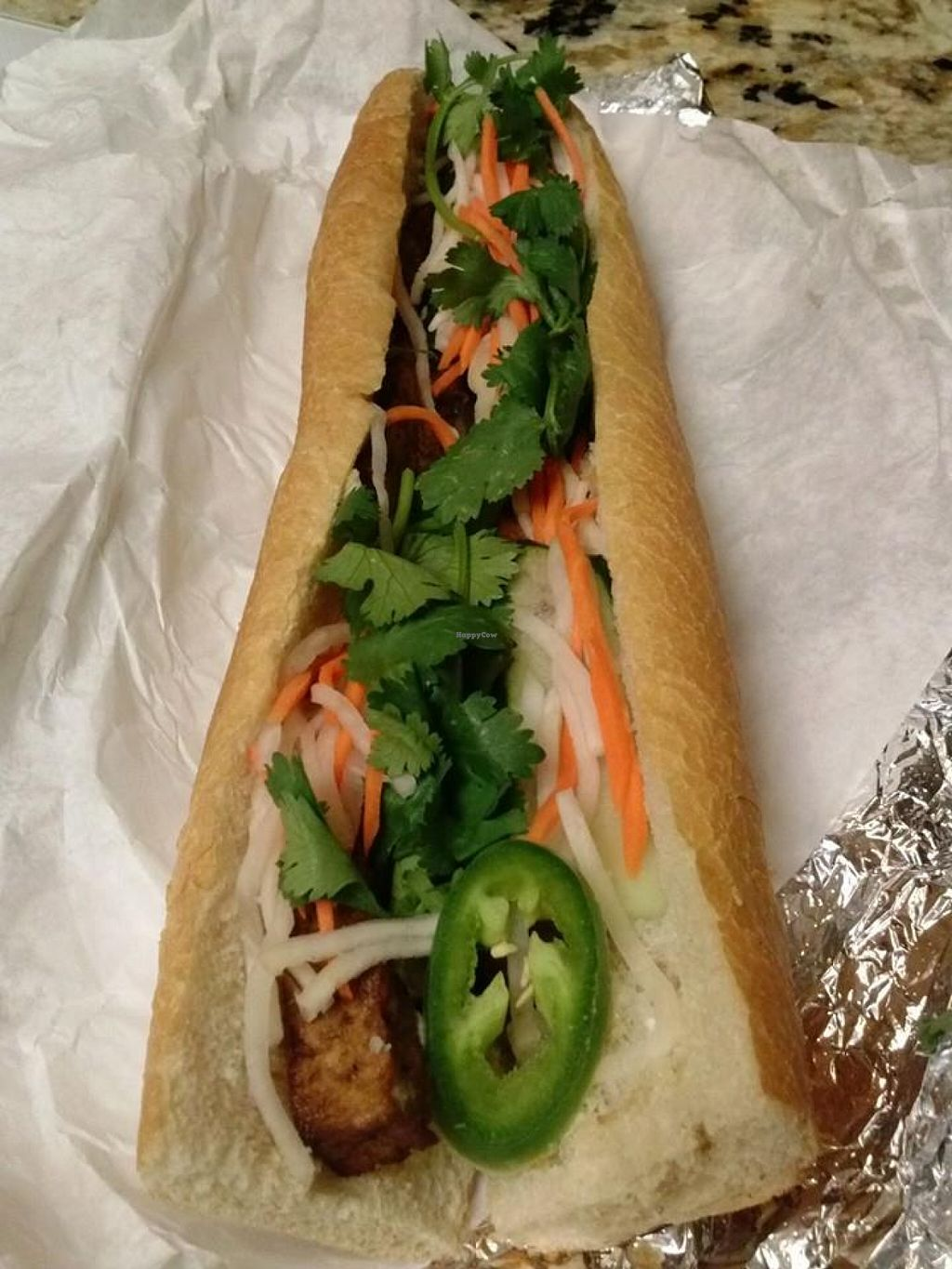 """Photo of REMOVED: Mandoline Grill - Food Truck  by <a href=""""/members/profile/Sonja%20and%20Dirk"""">Sonja and Dirk</a> <br/>banh mi <br/> August 10, 2015  - <a href='/contact/abuse/image/50015/113070'>Report</a>"""