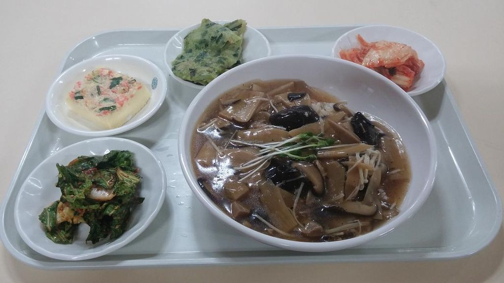 """Photo of Vegeland - 베지랜드  by <a href=""""/members/profile/arcticfox"""">arcticfox</a> <br/>bowl of rice topped with mushroom and sauce and the typical Korean side dishes <br/> February 23, 2015  - <a href='/contact/abuse/image/50201/93901'>Report</a>"""