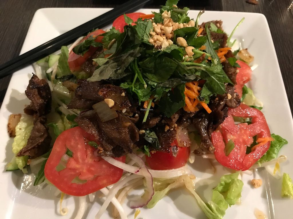 """Photo of Andy Nguyen's  by <a href=""""/members/profile/Alysoun%20Mahoney"""">Alysoun Mahoney</a> <br/>Spring """"beef"""" salad - with soy beef, mixed greens, tomatoes, carrots, daikon, caramelized onions, Asian herbs, & roasted peanuts in a soy vinaigrette <br/> October 6, 2017  - <a href='/contact/abuse/image/5021/312178'>Report</a>"""