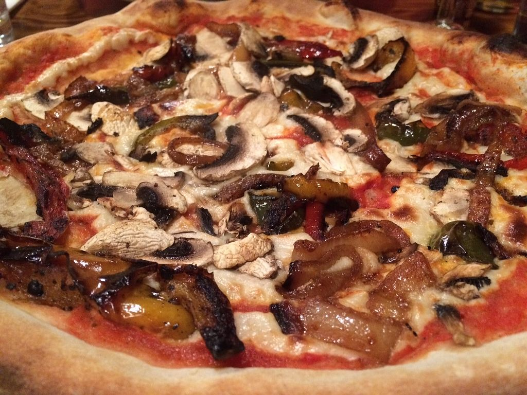 "Photo of The Hearth  by <a href=""/members/profile/Kiwi%20Wannabe"">Kiwi Wannabe</a> <br/>Don't miss The Hearth's delicious vegan pizza with loads of veggies, caramelized onions and cashew cheese :0)~ <br/> October 19, 2015  - <a href='/contact/abuse/image/50273/121888'>Report</a>"