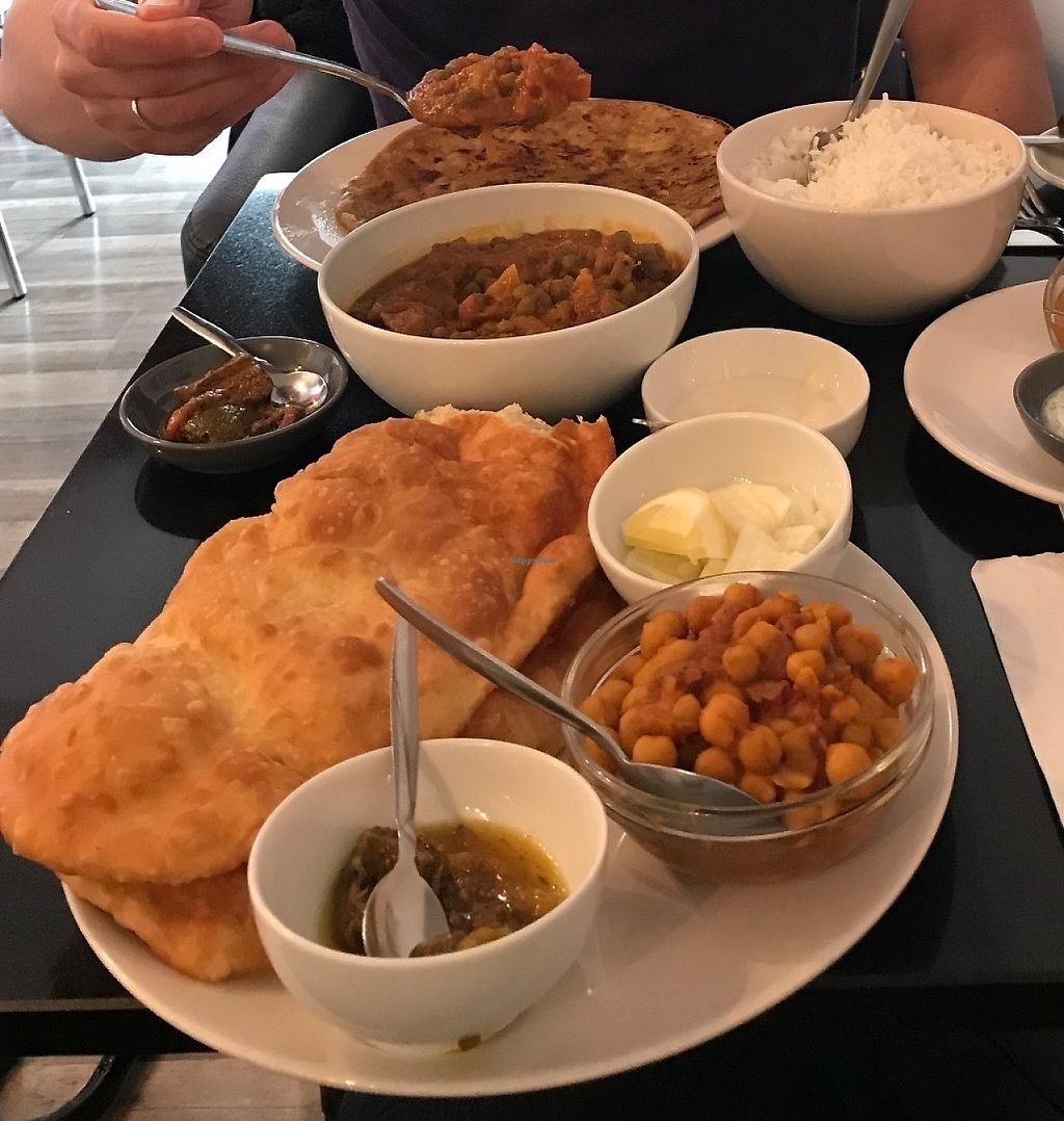 """Photo of Nirvana Cafe  by <a href=""""/members/profile/ClariFerrari"""">ClariFerrari</a> <br/>Chole bathura, mixed veg curry and side dish of parantha  <br/> May 4, 2017  - <a href='/contact/abuse/image/50299/255618'>Report</a>"""