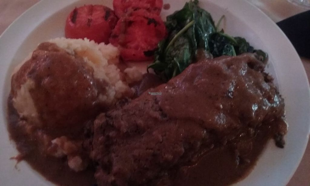 """Photo of Baba Yega  by <a href=""""/members/profile/veggie_htx"""">veggie_htx</a> <br/>Vegan hippie meatloaf. Comes with greens, roasted tomatoes and mashed potatoes <br/> August 12, 2016  - <a href='/contact/abuse/image/50520/167980'>Report</a>"""
