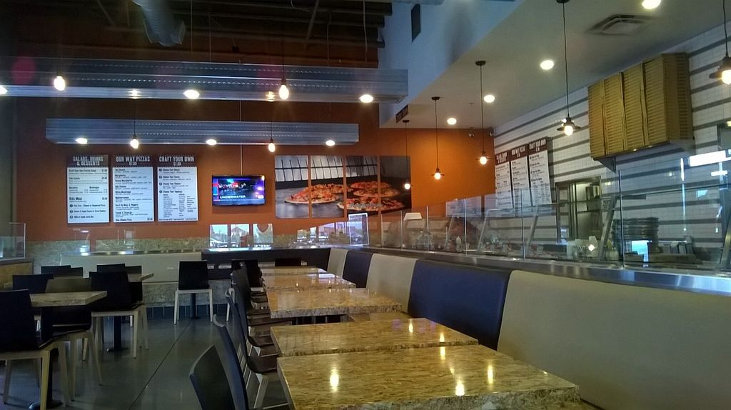 Photo of CLOSED: PizzaRev  by Navegante <br/>Interior, Oct 2015 <br/> October 6, 2015  - <a href='/contact/abuse/image/50539/120428'>Report</a>