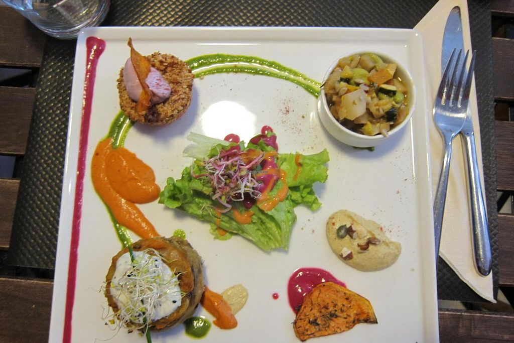 """Photo of Rest'o  by <a href=""""/members/profile/Aurelia"""">Aurelia</a> <br/>The daily vegan special. Every component was brimming with flavor, from the sauces to the roasted sweet-potato chips and tiny bowl of winter-veg stew <br/> December 9, 2014  - <a href='/contact/abuse/image/50697/87518'>Report</a>"""
