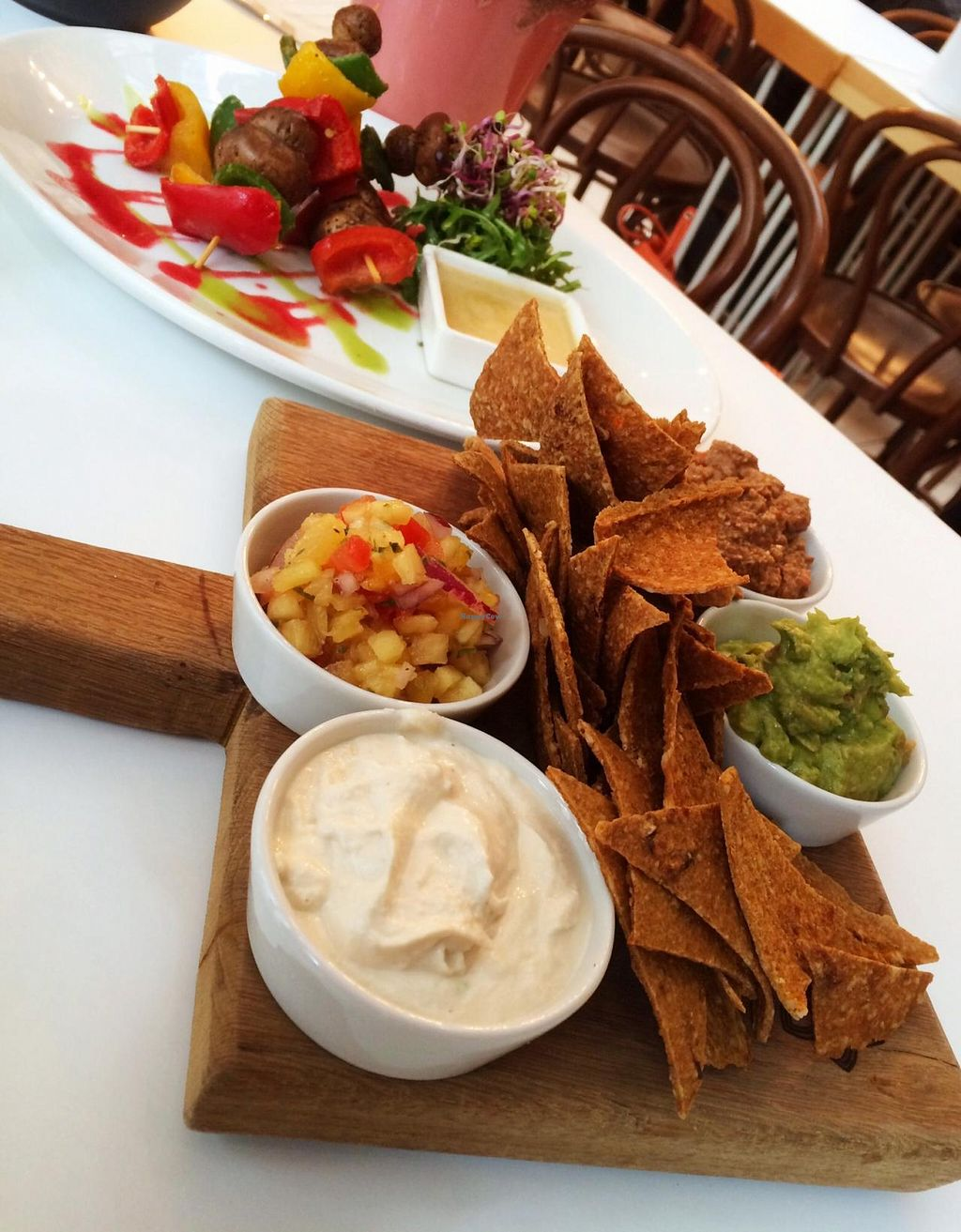 """Photo of Tanya's Cafe  by <a href=""""/members/profile/lysi"""">lysi</a> <br/>Vegan raw nachos with salsa, cashew nut cream cheeze, mushroom and walnut meat & raw kebabs  <br/> April 4, 2015  - <a href='/contact/abuse/image/50791/97775'>Report</a>"""