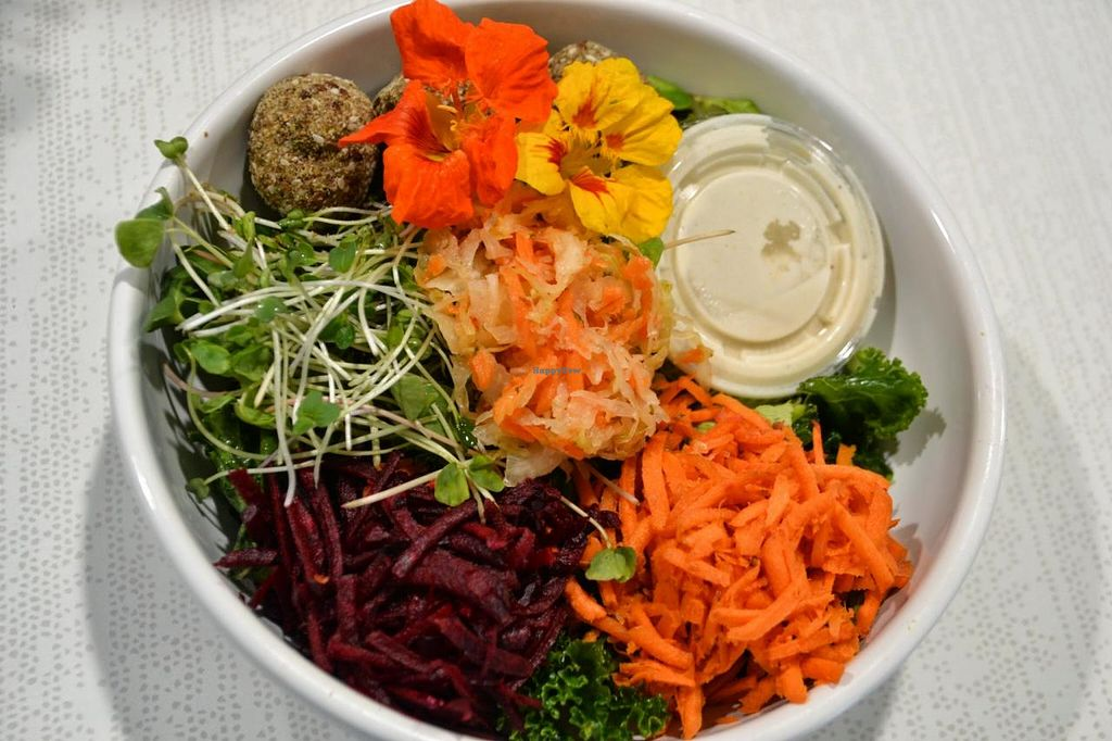 """Photo of Ezra's Enlightened Cafe  by <a href=""""/members/profile/earthychick"""">earthychick</a> <br/>Our Buddha Bowl is one of our mainstays. It has 3 Falafel Balls, shredded Beets, Carrots, Avocado & Curtido from Fermenti Artisan on top of Honey Spiced Kale. The Kale can be switched out to be made Vegan. Just mention it & Ezra's will happily comply <br/> October 23, 2014  - <a href='/contact/abuse/image/50895/83723'>Report</a>"""