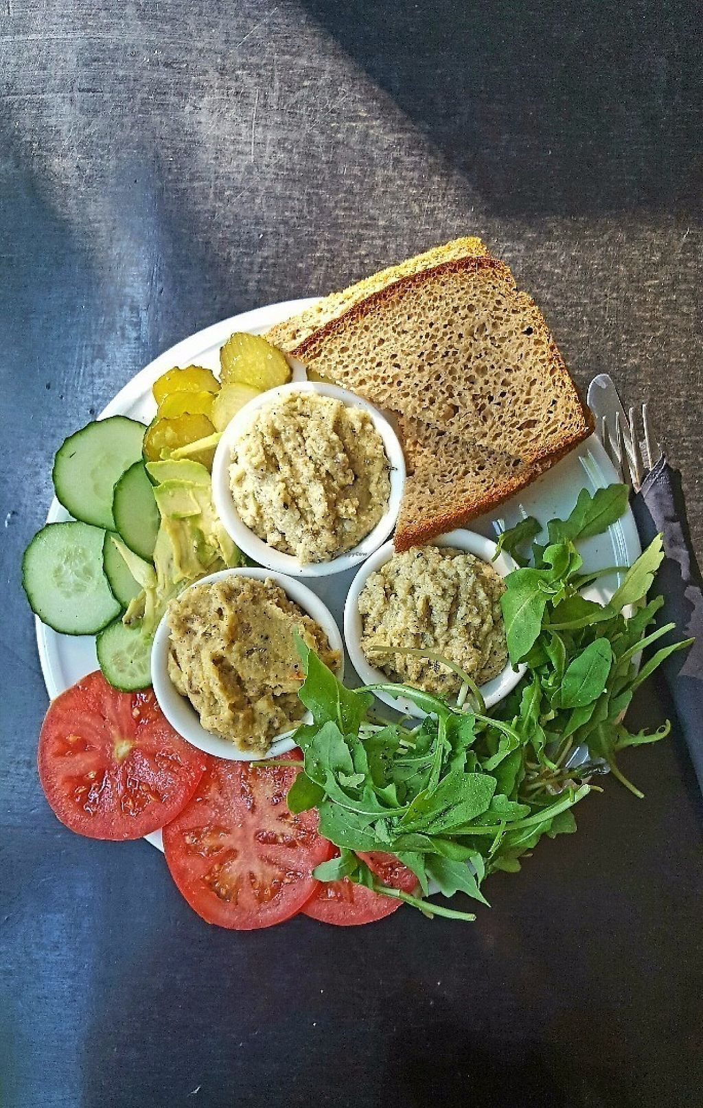 """Photo of Kawiarnia Fawory  by <a href=""""/members/profile/vanialuena"""">vanialuena</a> <br/>Kawiarnia Fawory, Krakow. Vegan Breakfast with 3 veggie spreads, bread and different fresh veggies (tomato, fresh cucumber, pickled cucumber & rocket salad) <br/> May 30, 2017  - <a href='/contact/abuse/image/50904/264207'>Report</a>"""