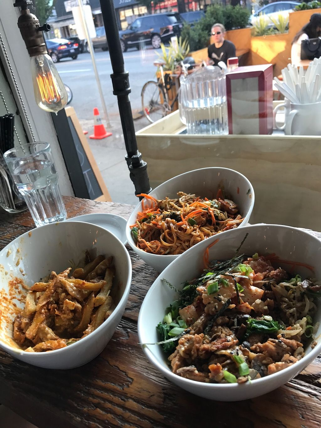 """Photo of MeeT on Main  by <a href=""""/members/profile/imsamanthalee"""">imsamanthalee</a> <br/>From left to right Butter Chickinw Poutine Pad Thai Seoul Bowl <br/> August 31, 2017  - <a href='/contact/abuse/image/51030/299383'>Report</a>"""