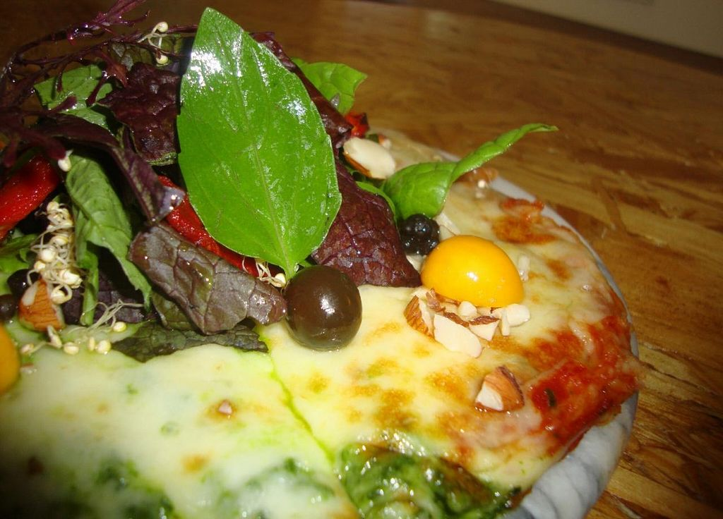 """Photo of Vegetarian by Franco  by <a href=""""/members/profile/Catherina"""">Catherina</a> <br/>Delicious artisanal pizza, half pesto and half pomodoro, with a mixed of greens, goldenberries and mucho more :) Vegan option available.  <br/> September 7, 2014  - <a href='/contact/abuse/image/51046/79281'>Report</a>"""