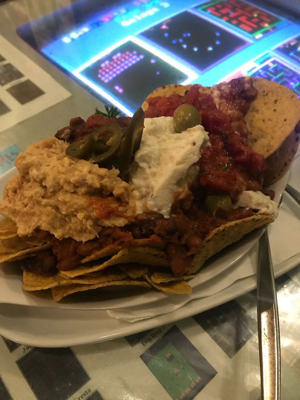 "Photo of Midnight Espresso Bar  by <a href=""/members/profile/TianaNelson"">TianaNelson</a> <br/>Nachos! Vegan. So good <br/> February 25, 2018  - <a href='/contact/abuse/image/5126/363511'>Report</a>"