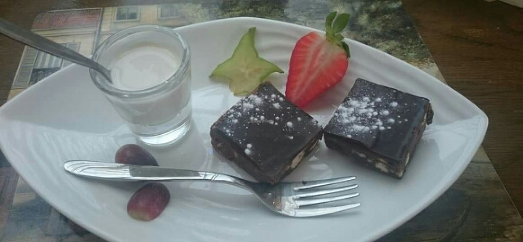 """Photo of The Golden Lion Pub  by <a href=""""/members/profile/Gupalsmurthpadacal"""">Gupalsmurthpadacal</a> <br/>vegan chocolate tin brownie <br/> May 7, 2016  - <a href='/contact/abuse/image/51301/147859'>Report</a>"""
