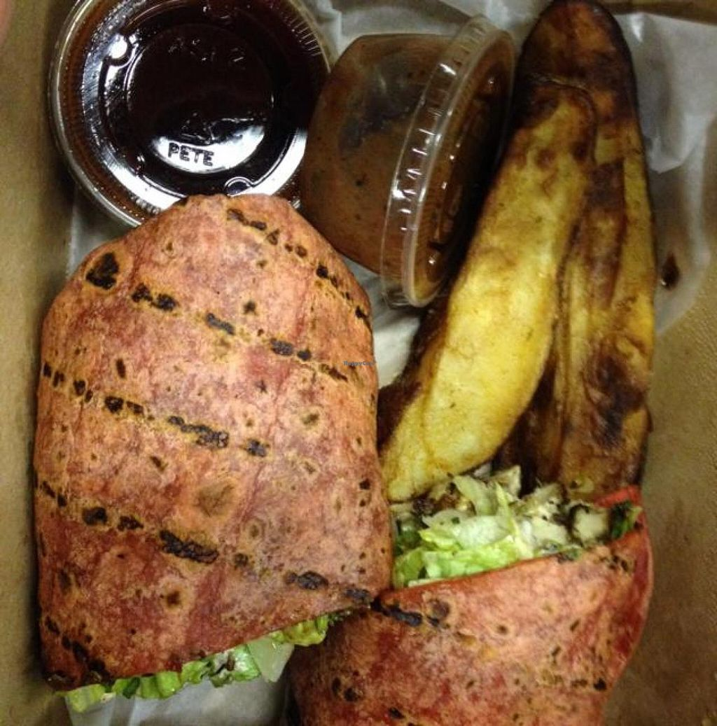 "Photo of CLOSED: Karyn's Cooked  by <a href=""/members/profile/Tigra220"">Tigra220</a> <br/>Jerk Tofu Wrap with potatoe wedges, BBQ dipping sauce, & extra jerk sauce <br/> November 16, 2014  - <a href='/contact/abuse/image/5130/85798'>Report</a>"