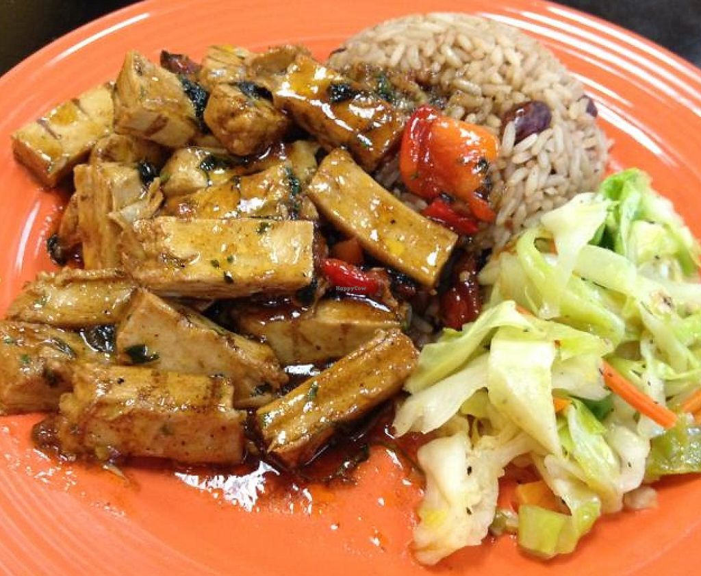 """Photo of Caribbean Spice  by <a href=""""/members/profile/Tigra220"""">Tigra220</a> <br/>Vegan Jerk 'Chicken' plate w/ beans & rice, and cabbage <br/> September 26, 2014  - <a href='/contact/abuse/image/51740/189720'>Report</a>"""