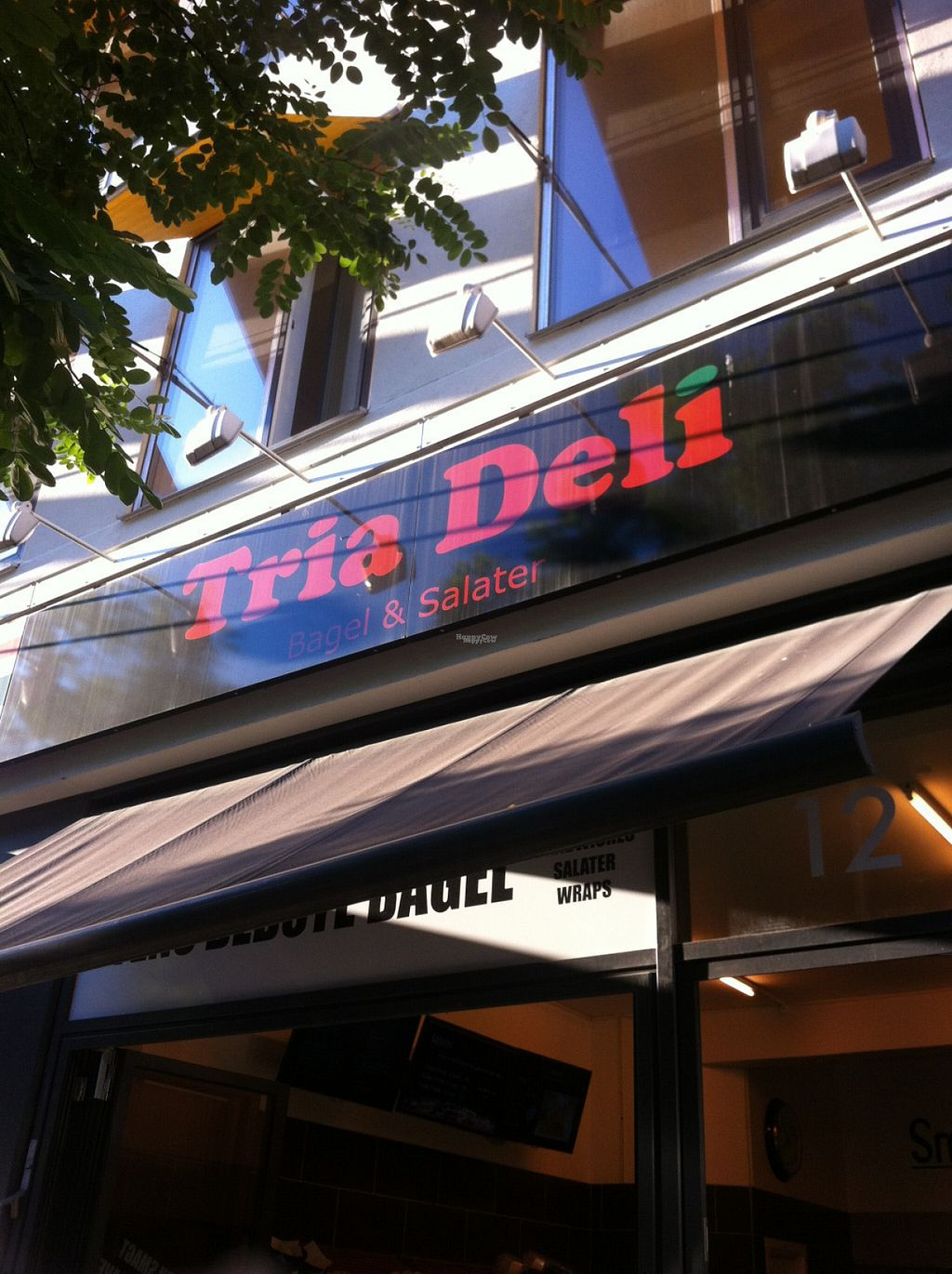 """Photo of CLOSED: Tria Deli  by <a href=""""/members/profile/piffelina"""">piffelina</a> <br/>Cafe hidden behind a tree, a little hard to see <br/> August 3, 2016  - <a href='/contact/abuse/image/51837/164802'>Report</a>"""