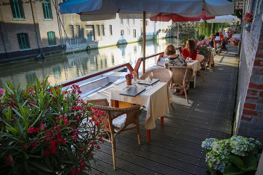 """Photo of De Panda  by <a href=""""/members/profile/Tiny9"""">Tiny9</a> <br/>charming terras next to the river <br/> August 26, 2014  - <a href='/contact/abuse/image/5191/78254'>Report</a>"""