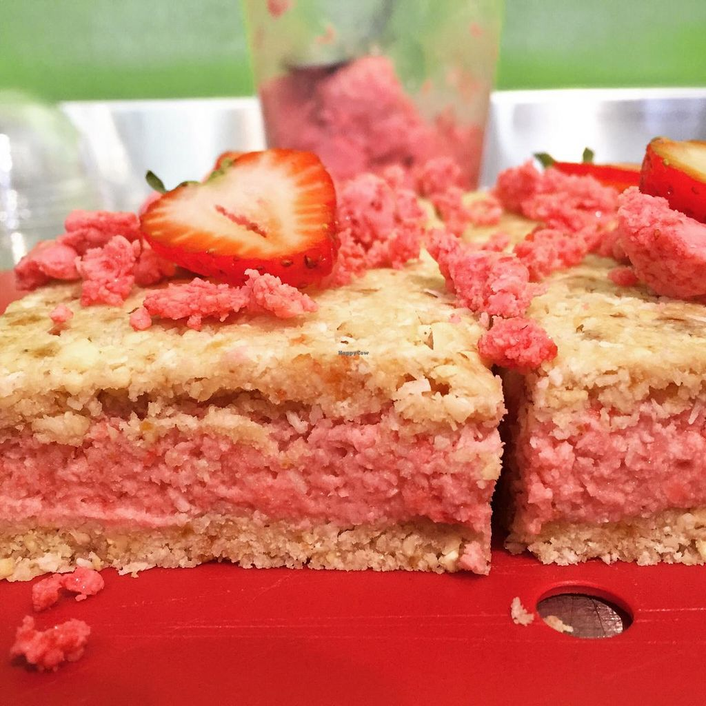 """Photo of Margaret River Juice Company  by <a href=""""/members/profile/Margaret%20River"""">Margaret River</a> <br/>Raw coconut and strawberry slice  <br/> March 1, 2015  - <a href='/contact/abuse/image/52003/94418'>Report</a>"""