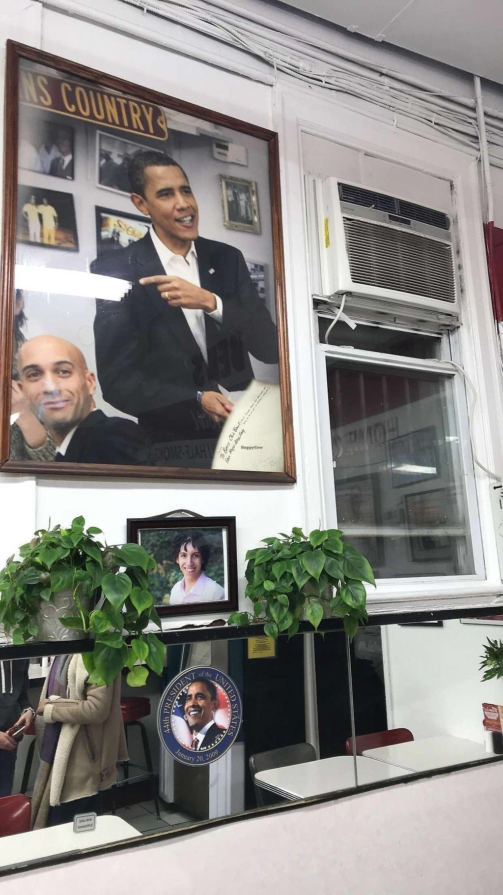 """Photo of Ben's Chili Bowl  by <a href=""""/members/profile/20daisy00"""">20daisy00</a> <br/>Obama portrate above the table he famously ate at, after winning the '08 election <br/> February 25, 2018  - <a href='/contact/abuse/image/52127/363695'>Report</a>"""