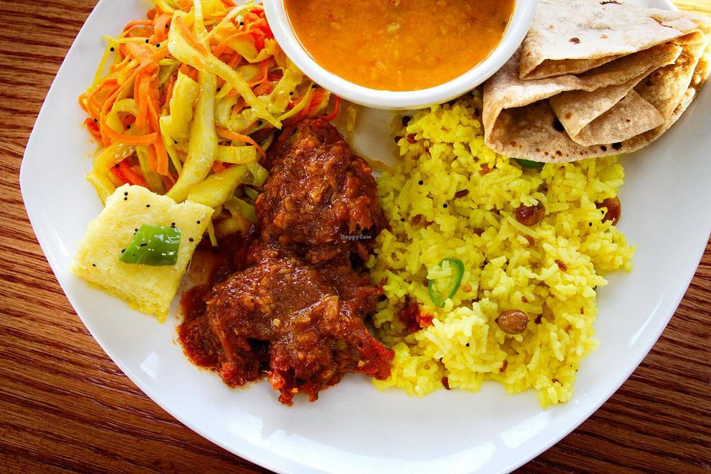 """Photo of Nimai's Bliss Kitchen  by <a href=""""/members/profile/HariRaval"""">HariRaval</a> <br/>A meal from the Nimai's Bliss Kitchen buffet. Starting from the top clockwise: lentil soup, chappati bread, lemon rice, kofta (chickpea flour and zucchini in a tomato base sauce), khaman (steamed chickpea flour bread) and warm cole slaw <br/> December 6, 2014  - <a href='/contact/abuse/image/52294/87374'>Report</a>"""
