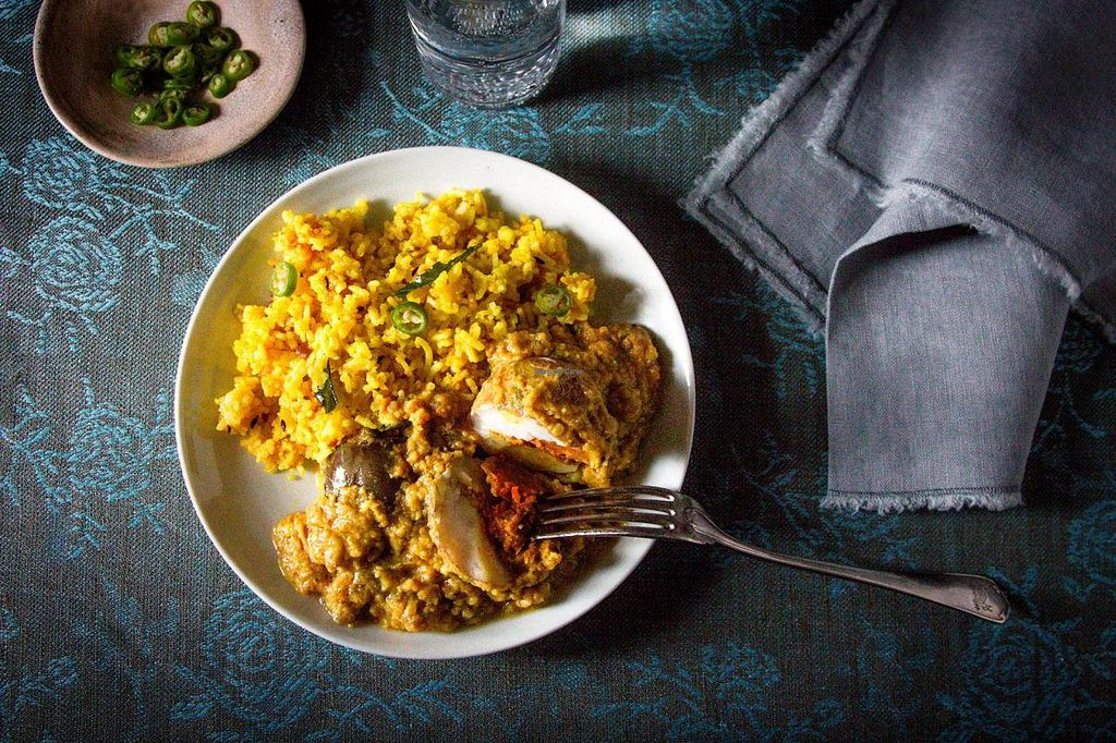 """Photo of Nimai's Bliss Kitchen  by <a href=""""/members/profile/HariRaval"""">HariRaval</a> <br/>Sambhar Nu Shaak (stuffed eggplant and potatoes in a chickpea flour sauce) and tamarind rice.  <br/> December 6, 2014  - <a href='/contact/abuse/image/52294/87376'>Report</a>"""