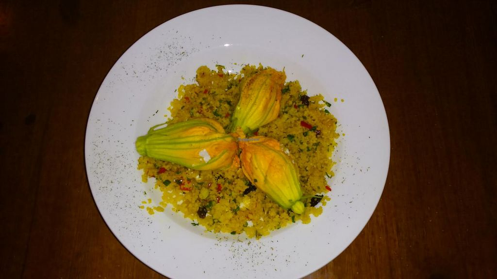 "Photo of Fargo  by <a href=""/members/profile/AdrNda"">AdrNda</a> <br/>Vegetable Cous Cous with zucchini flowers stuffed with vegan cheese <br/> June 4, 2015  - <a href='/contact/abuse/image/52314/104794'>Report</a>"