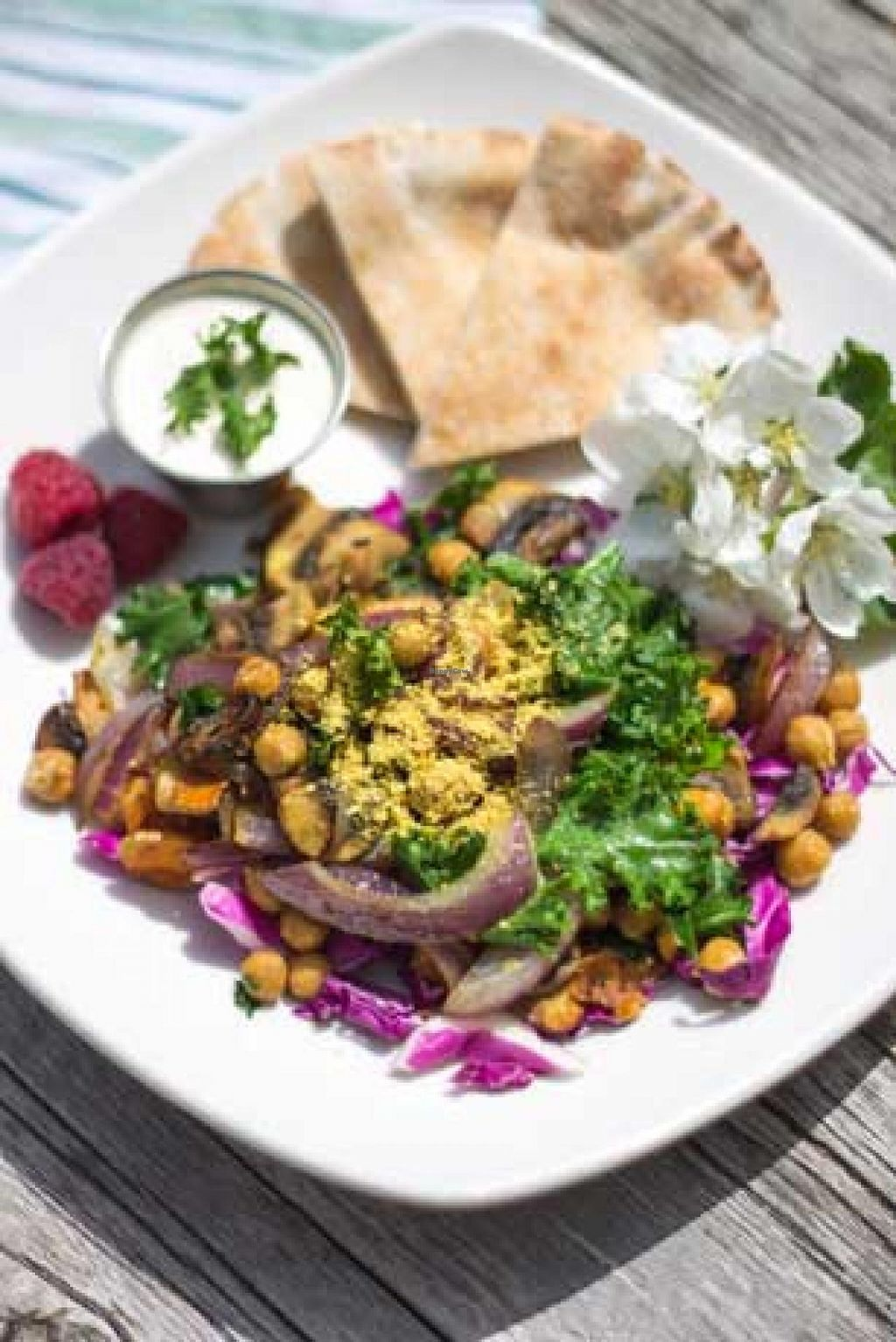 """Photo of Roni's Kitchen  by <a href=""""/members/profile/RonisKitchen"""">RonisKitchen</a> <br/>Chickpea Scramble- Seared, spiced red onions, fresh turmeric, mushrooms, kale & chickpeas on a bed of fresh red cabbage and sprinkled with nutritional yeast. Served with tahini and organic whole-wheat pita <br/> July 8, 2015  - <a href='/contact/abuse/image/52840/108594'>Report</a>"""
