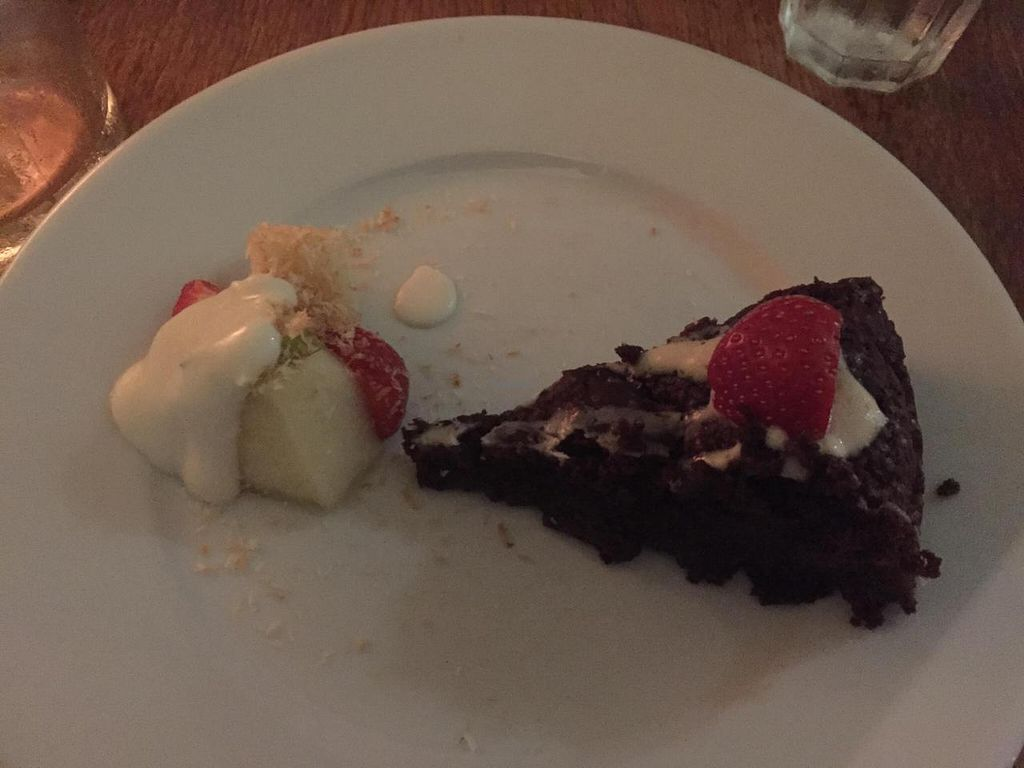 """Photo of CLOSED: Black Bear Cafe  by <a href=""""/members/profile/sriblet"""">sriblet</a> <br/>Vegan Chocolate Cake Slice with Small Fruit Salad Side <br/> November 30, 2014  - <a href='/contact/abuse/image/52889/86867'>Report</a>"""
