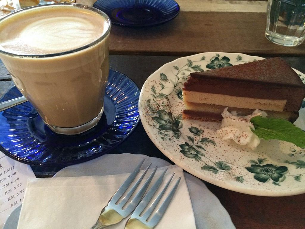 """Photo of CLOSED: Einstein Cafe  by <a href=""""/members/profile/ElenaKorovina"""">ElenaKorovina</a> <br/>Latte+chocolate cake <br/> May 29, 2015  - <a href='/contact/abuse/image/53125/103977'>Report</a>"""
