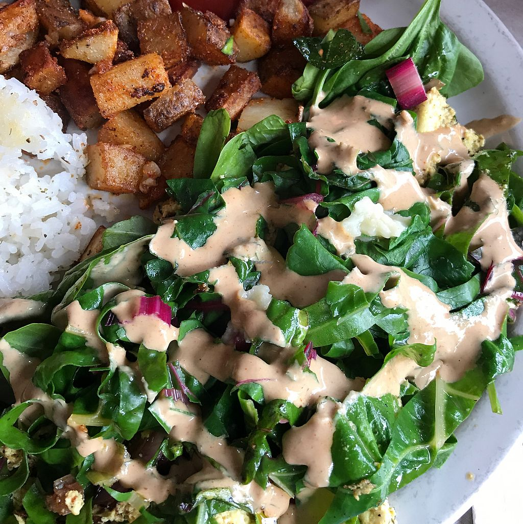 "Photo of New Moon Cooperative Cafe  by <a href=""/members/profile/Raynevegan"">Raynevegan</a> <br/>tofu scramble with greens, home fries, and rice medallion  <br/> September 9, 2017  - <a href='/contact/abuse/image/5341/302610'>Report</a>"