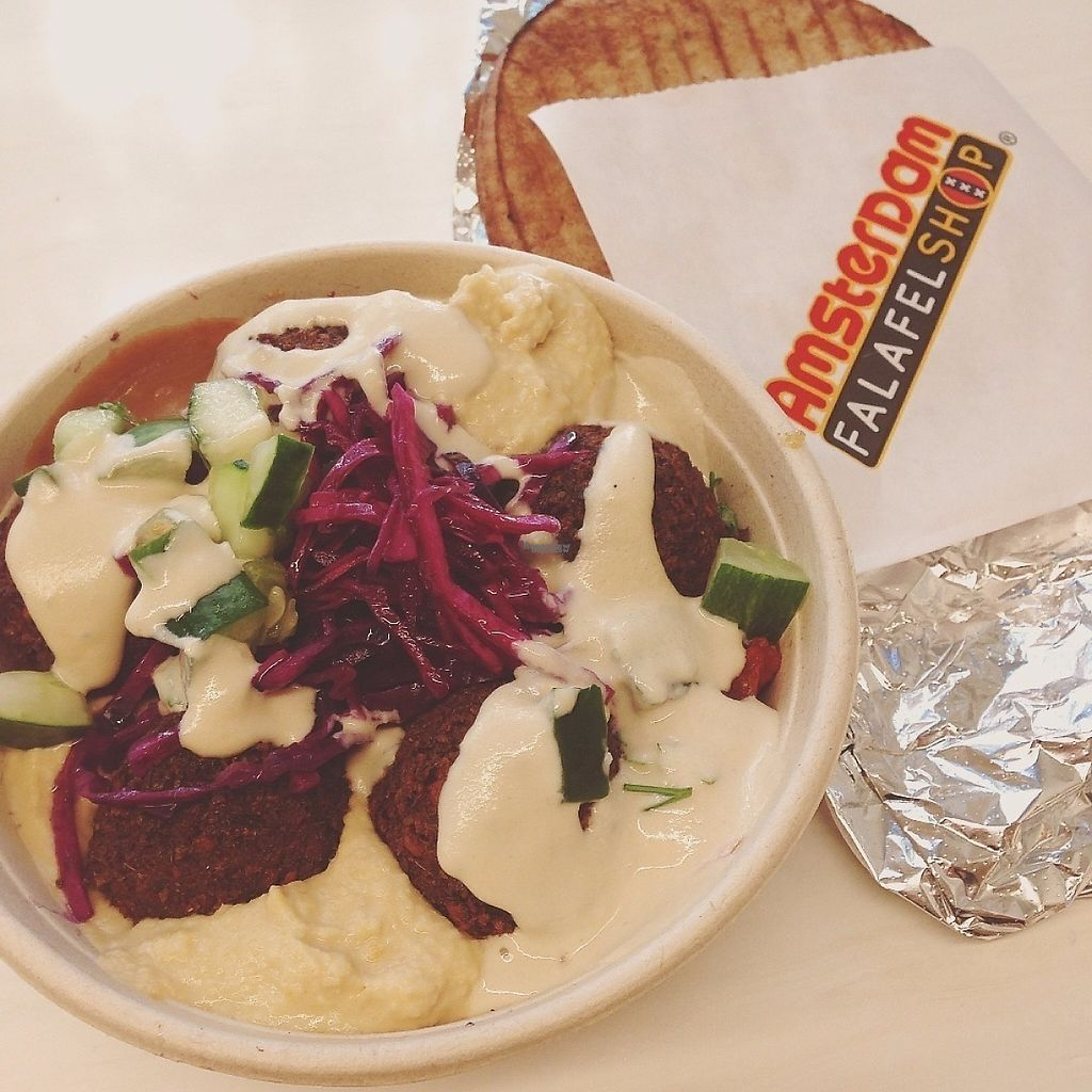 """Photo of Amsterdam Falafelshop - L'Enfant Plaza  by <a href=""""/members/profile/oleiah"""">oleiah</a> <br/>Falafel salad: looks like it's all sauce and hummus but there were more veggies under there, I promise! Pita on the side <br/> March 13, 2017  - <a href='/contact/abuse/image/53593/235940'>Report</a>"""