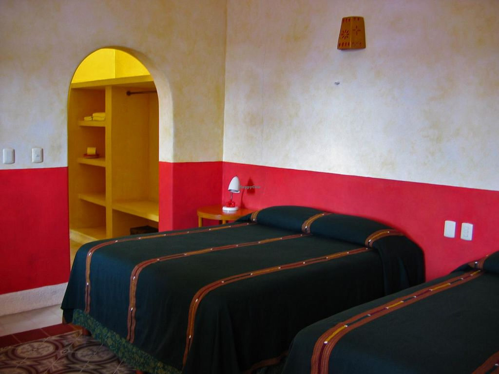 "Photo of Hotel MedioMundo  by <a href=""/members/profile/aguasturquesas"">aguasturquesas</a> <br/>Guestroom with two queen beds and air conditioning <br/> December 26, 2014  - <a href='/contact/abuse/image/53612/88770'>Report</a>"