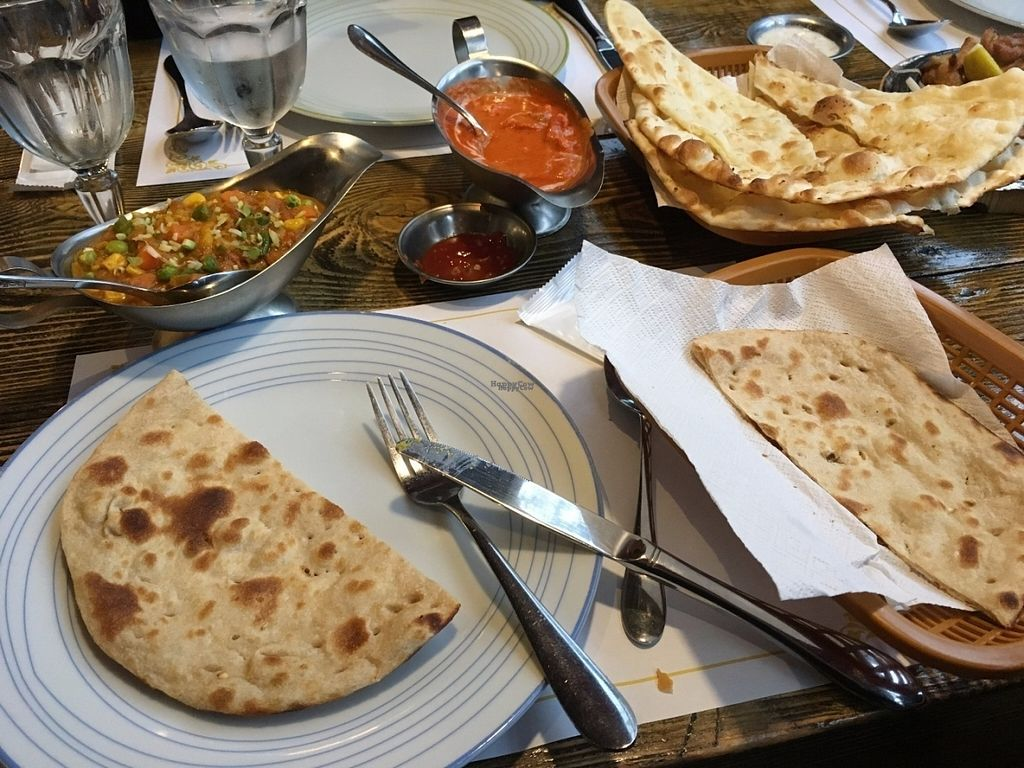 "Photo of Namaskar  by <a href=""/members/profile/safell"">safell</a> <br/>vegetable curry, indian bread. Naan bread and (idontrememberthename) curry in the center <br/> September 30, 2016  - <a href='/contact/abuse/image/53721/178728'>Report</a>"