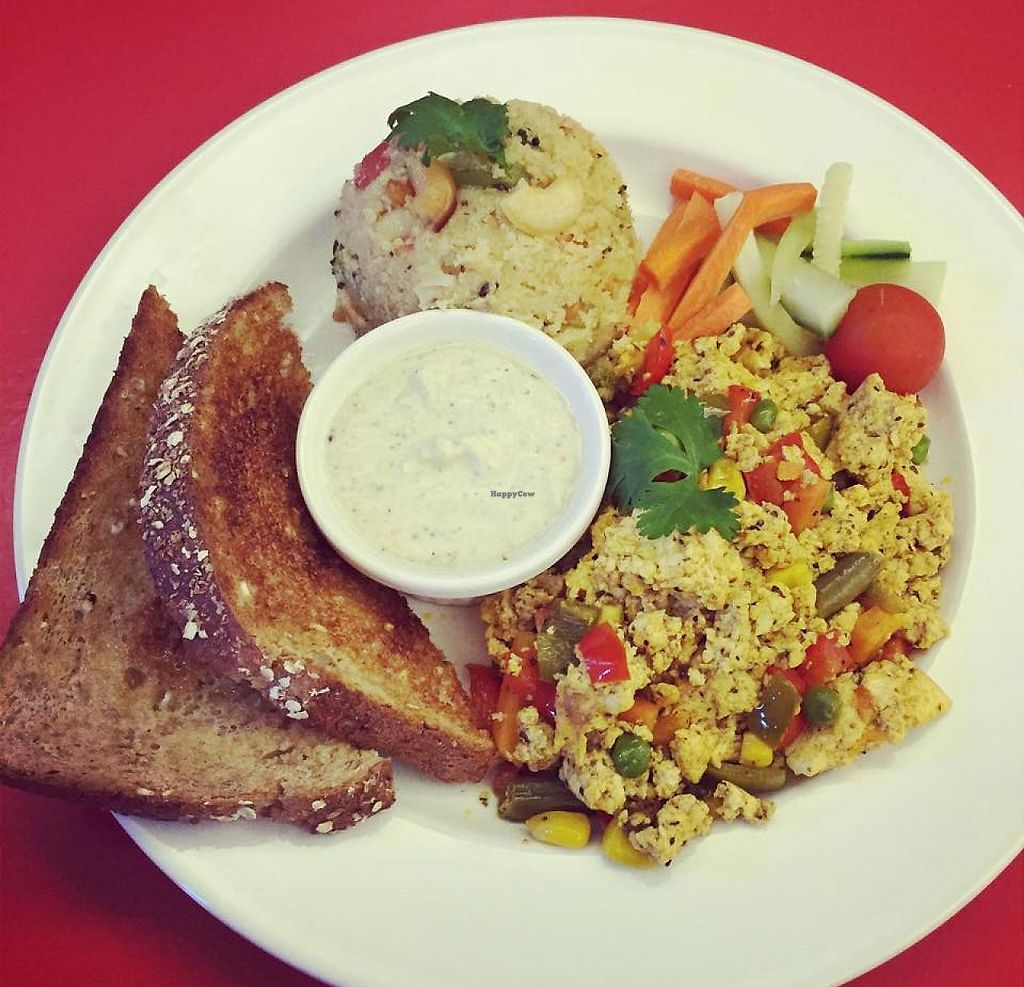 """Photo of Good Karma Cafe  by <a href=""""/members/profile/rstrampello6570"""">rstrampello6570</a> <br/>Scrambled Tofu, Upma (roasted Cream of Wheat with vegetables), Coconut Chutney, and Toast <br/> December 13, 2014  - <a href='/contact/abuse/image/53789/201378'>Report</a>"""