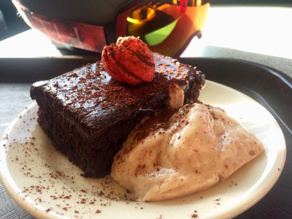 "Photo of Raven's Nest  by <a href=""/members/profile/Hayley143"">Hayley143</a> <br/>Delicious vegan brownie with coconut cream at Raven's Nest!  Yum! <br/> February 2, 2016  - <a href='/contact/abuse/image/54014/134746'>Report</a>"