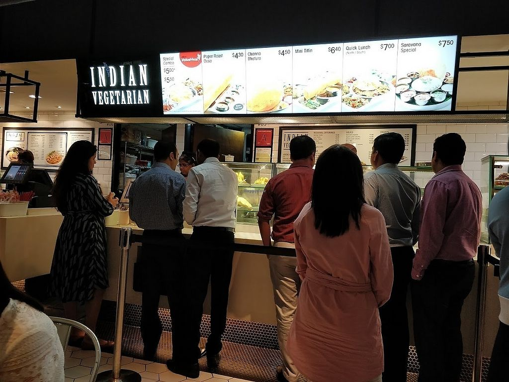 "Photo of Saravana Bhavan - Raffles Place  by <a href=""/members/profile/JimmySeah"">JimmySeah</a> <br/>lunch time crowd in front of stall  <br/> April 2, 2018  - <a href='/contact/abuse/image/54279/379826'>Report</a>"
