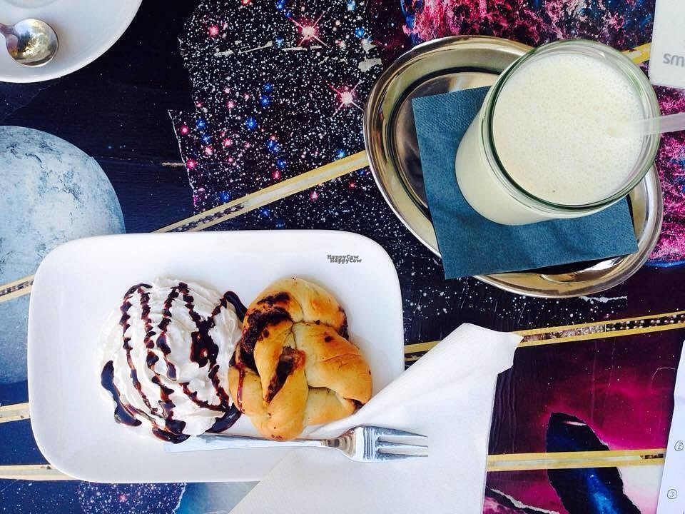 """Photo of Valladares  by <a href=""""/members/profile/Kyttiara"""">Kyttiara</a> <br/>small pastry with creme and a banana lassi <br/> September 28, 2016  - <a href='/contact/abuse/image/54507/178300'>Report</a>"""