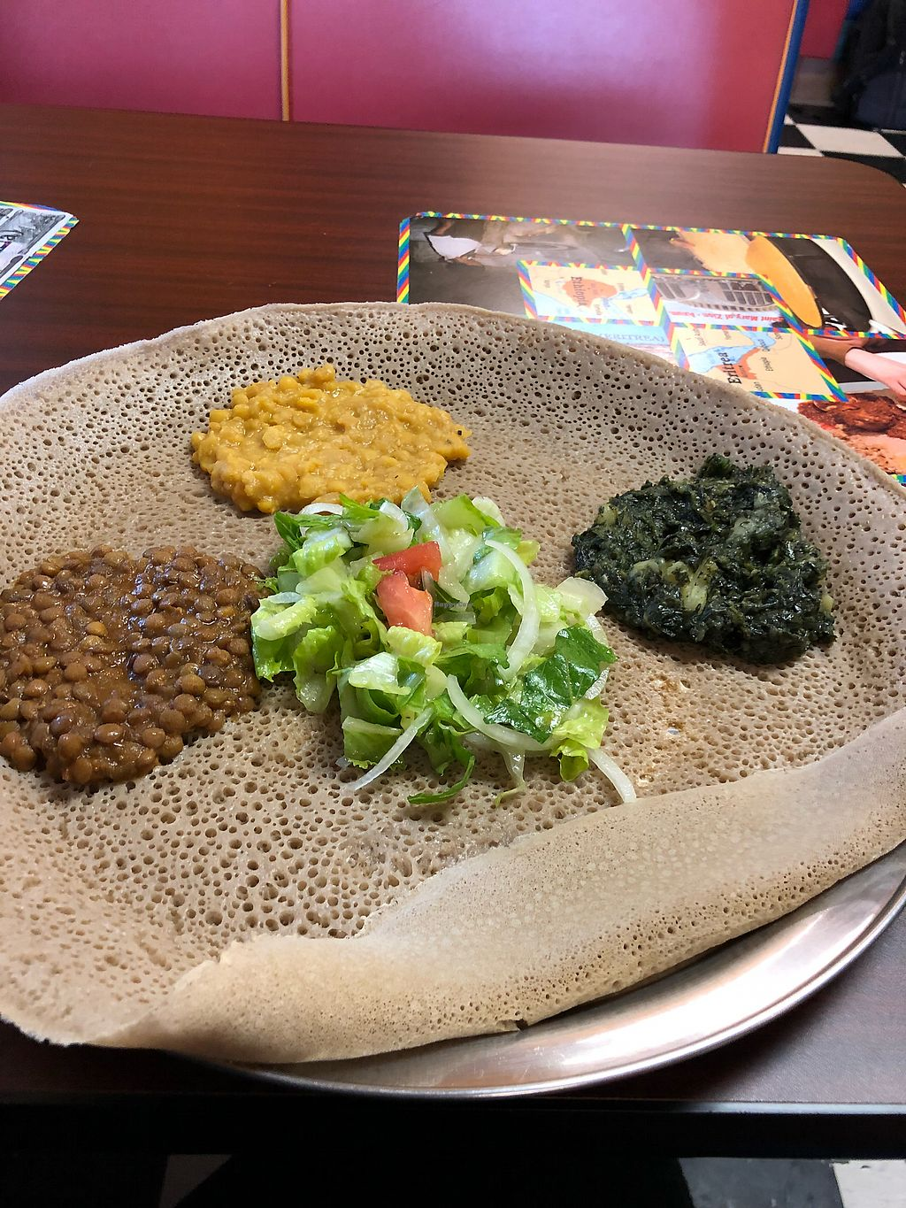"""Photo of Kibrom's Restaurant  by <a href=""""/members/profile/LinnDaugherty"""">LinnDaugherty</a> <br/>#19, yellow lentil, and kale potato - comes with the salad and the bread which you eat the sides with  <br/> April 16, 2018  - <a href='/contact/abuse/image/54717/386569'>Report</a>"""