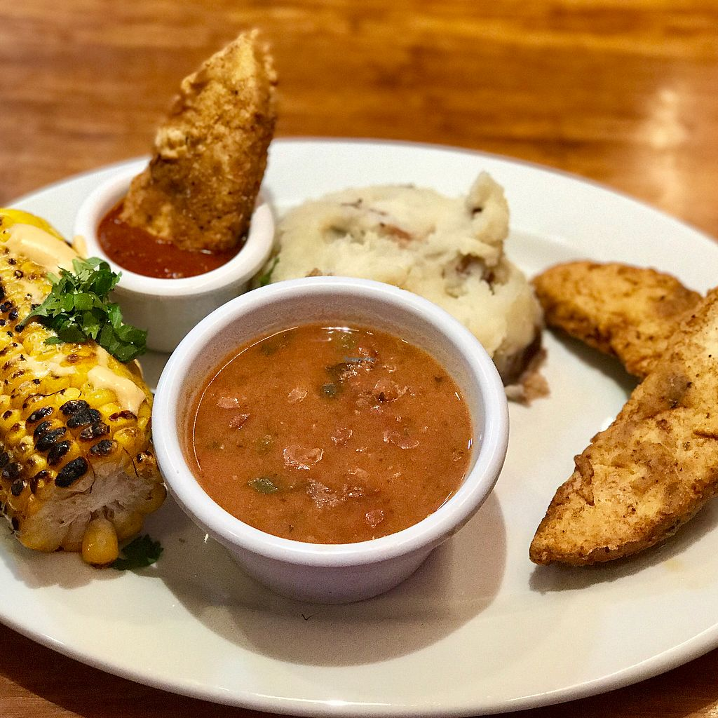 "Photo of Veggie Grill  by <a href=""/members/profile/dnmatty"">dnmatty</a> <br/>Backyard Spicy Fried Chickin' (New!) 3pc. spicy fried chickin', ½ street corn, pinto bean stew, cauli-mashed potatoes+porcini gravy, BBQ sauce ($12.50) <br/> August 26, 2017  - <a href='/contact/abuse/image/54764/297445'>Report</a>"