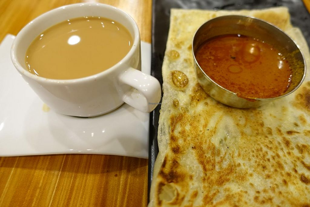 """Photo of Gopal's Vegetarian Restaurant  by <a href=""""/members/profile/JimmySeah"""">JimmySeah</a> <br/>cheese prata with ginger tea <br/> January 19, 2015  - <a href='/contact/abuse/image/54869/90679'>Report</a>"""