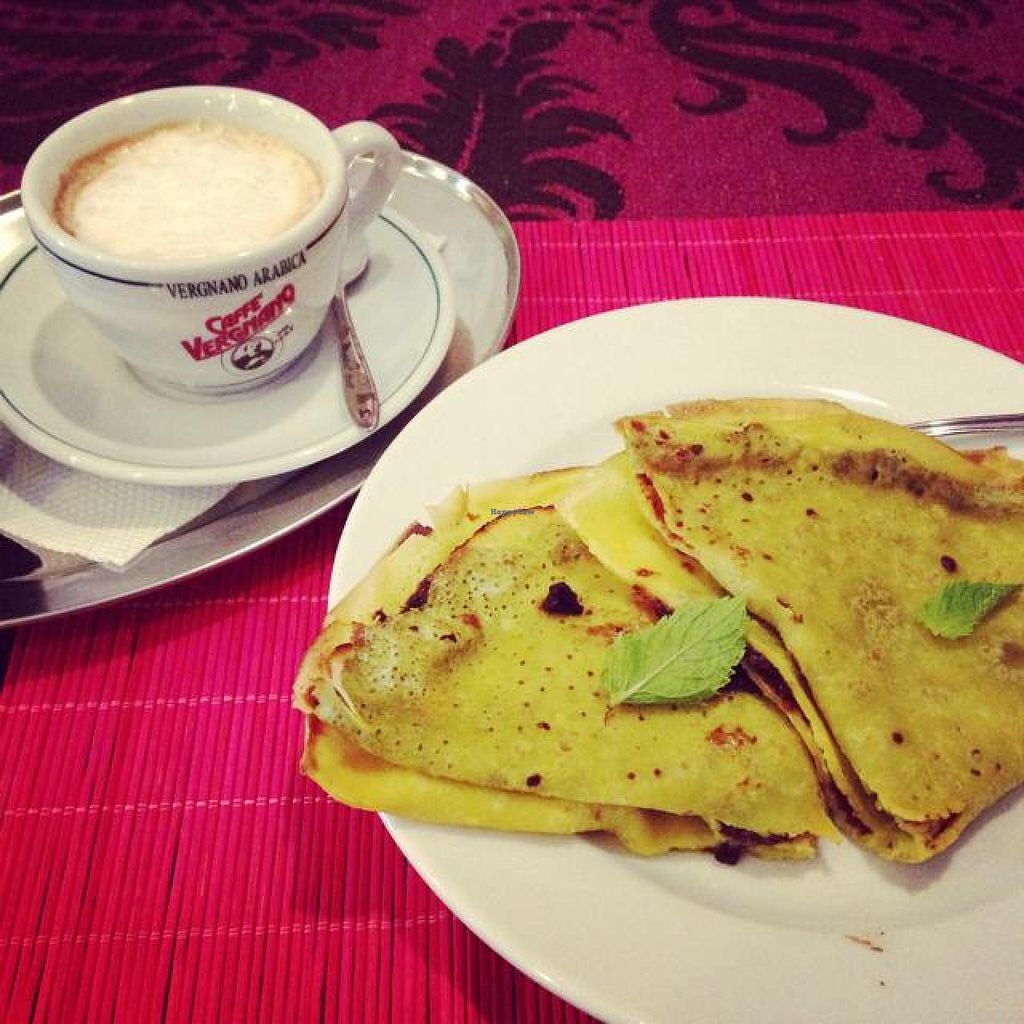 """Photo of Edeni Vegan  by <a href=""""/members/profile/Pitanguinha"""">Pitanguinha</a> <br/>cappuccino with coconut milk and palacsinta pancakes with plumb jam <br/> September 20, 2014  - <a href='/contact/abuse/image/5490/80467'>Report</a>"""