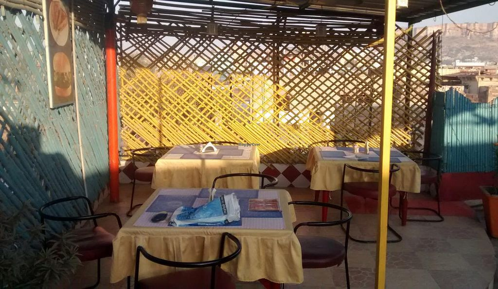 Photo of Govind Hotel Restaurant  by zungi <br/>part of the dining area with fort in the background <br/> February 2, 2015  - <a href='/contact/abuse/image/55300/92035'>Report</a>