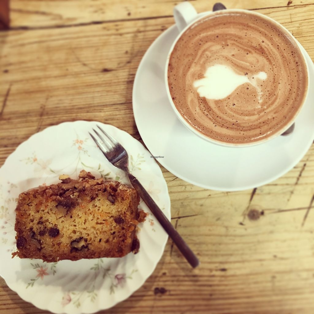 """Photo of Offbeet Food  by <a href=""""/members/profile/GeorginaAlyssa"""">GeorginaAlyssa</a> <br/>Walnut, carrot and raisin cake, with a hot chocolate!  <br/> November 11, 2015  - <a href='/contact/abuse/image/55388/124642'>Report</a>"""