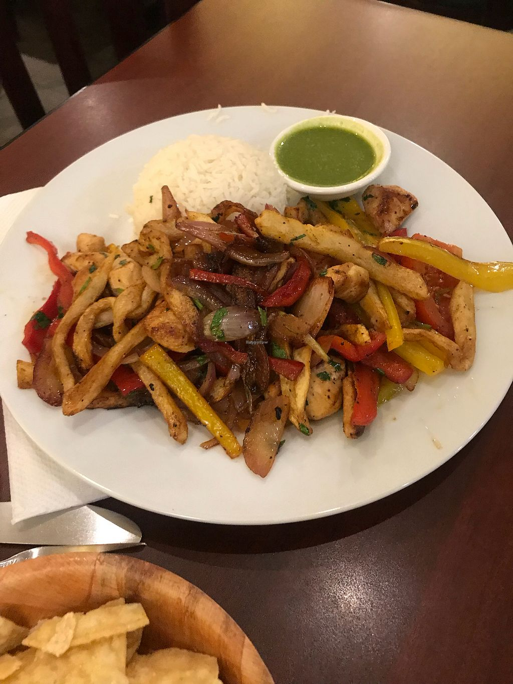 """Photo of un solo sol  by <a href=""""/members/profile/Vegan_Ness"""">Vegan_Ness</a> <br/>Tofu Saltado (fries w/ bell peppers and onions) <br/> October 7, 2017  - <a href='/contact/abuse/image/55390/312563'>Report</a>"""
