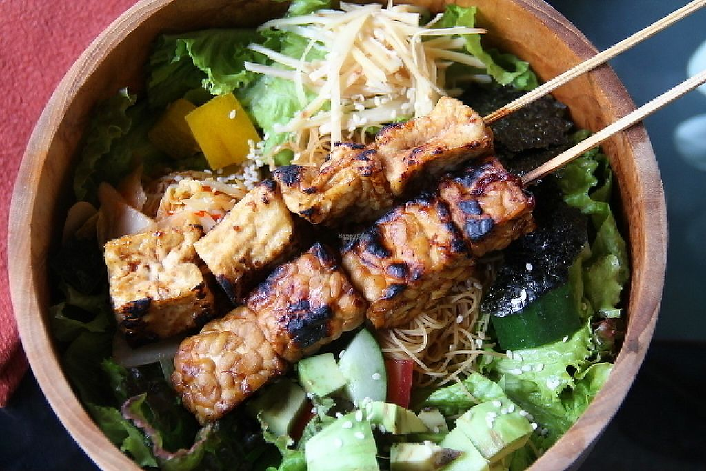 """Photo of Kismet Cafe and Boutique  by <a href=""""/members/profile/reissausta%20ja%20ruokaa"""">reissausta ja ruokaa</a> <br/>Asian bowl with tofu and tempe satays.  <br/> November 13, 2016  - <a href='/contact/abuse/image/55831/189618'>Report</a>"""
