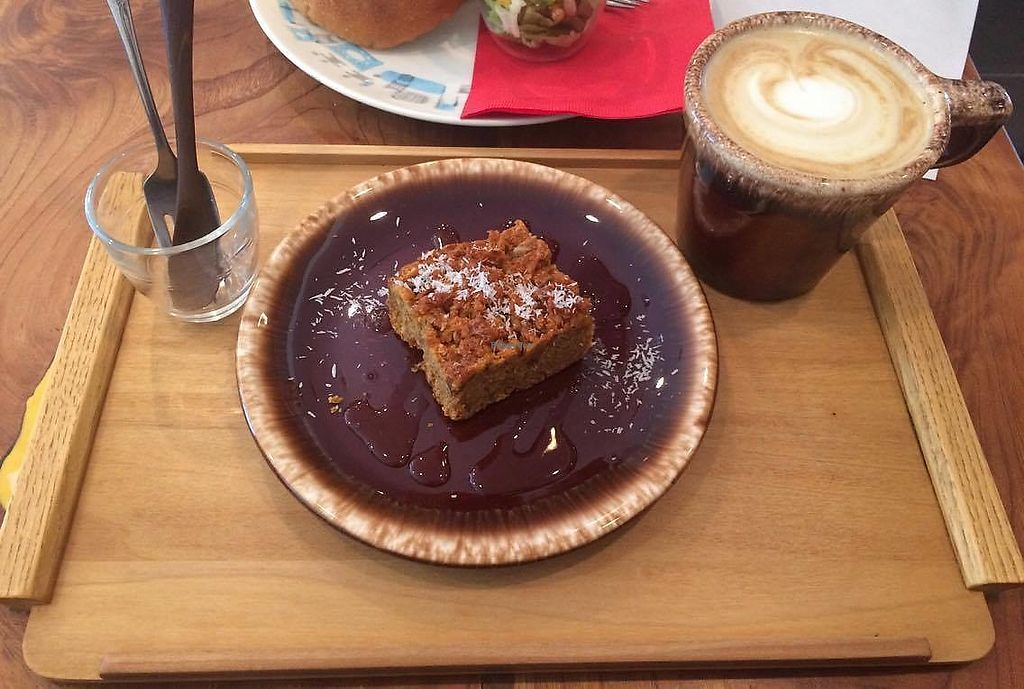 """Photo of Phalam Cafe  by <a href=""""/members/profile/yanina"""">yanina</a> <br/>Soymilk Latte and Carrot-cocunut cake  <br/> October 15, 2017  - <a href='/contact/abuse/image/55894/315315'>Report</a>"""
