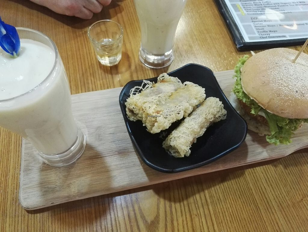 """Photo of NomVnom - Clarke Quay  by <a href=""""/members/profile/lea.1323"""">lea.1323</a> <br/>Banana smoothie, Vietnamese yam rolls and the Potato Croquette Burger <br/> July 16, 2017  - <a href='/contact/abuse/image/55908/280804'>Report</a>"""
