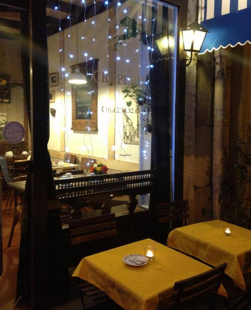 "Photo of Mad'eo  by <a href=""/members/profile/lafollia"">lafollia</a> <br/>Cosy, little crêperie. They have antique wooden Breton furniture and photos of their family in traditional dress on the walls <br/> February 25, 2015  - <a href='/contact/abuse/image/55930/94070'>Report</a>"